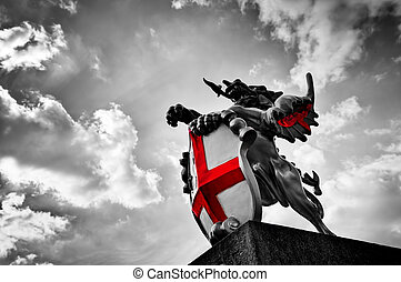 St George dragon statue in London, the UK. Black and white, red flag, shield.