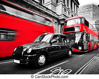 Symbols of London, the UK. Red buses, black taxi cab. Black...