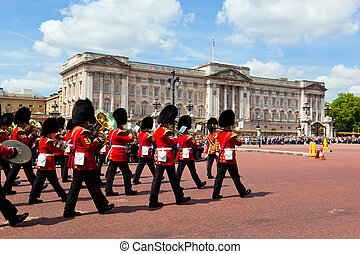 British Royal guards perform the Changing of the Guard in...
