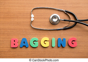 Bagging colorful word with stethoscope on the wooden...