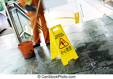 Danger Sign Cautionin Progress - cleaning in progress, and...