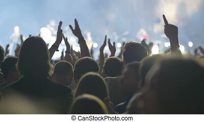 People claping hands on the grand pop concert - Slow motion...