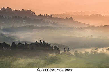 Tuscany Village Landscape on a Misty Morning in July -...