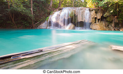 Blue stream waterfalls in deep jungle in Thailand national...