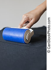 Lint roller on black cloth