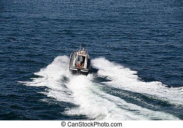 fast motorboat on the sea - fast moving motorboat on the sea