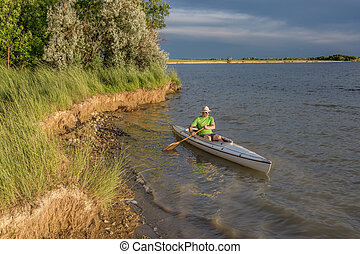 canoe paddling on lake in Colorado