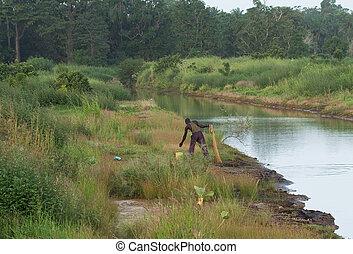 Man fishing at Pirang