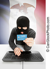 Hacker holding credit card with US state flag on background - Iowa