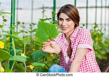Gardening and having fun - Beautiful young woman gardening...