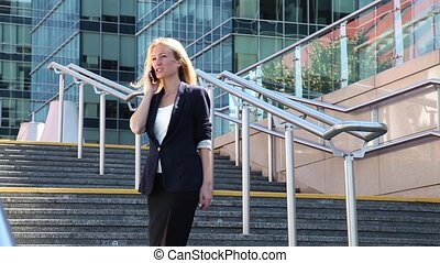 Business woman on phone - Business woman standing on the...