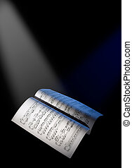 Music sheets under the reflector lights