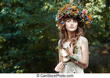Portrait cute girl with wreath of flowers. - Portrait of a...