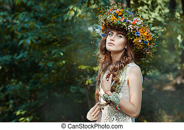 In the forest a cute girl. She has beautiful hair and a...