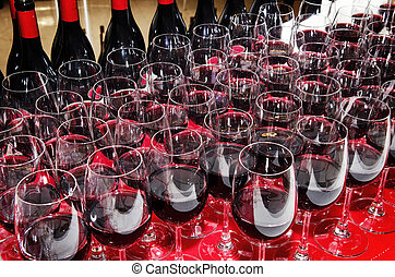 red wine glasses and bottles at cocktail party