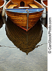 Boat Reflection - Reflection of small boat moored in shallow...