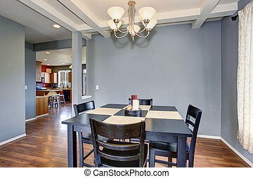 simplistic dinning room with gray walls. - Simplistic...