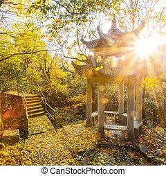 Autumn landscape with pavilion