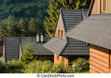 traditional wooden chalets with slated roofs