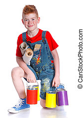 Little painter Adorable boy with a paint brush and paint can...