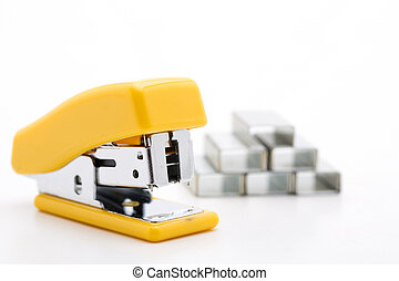 Stapler with staples yellow lines on a white background.