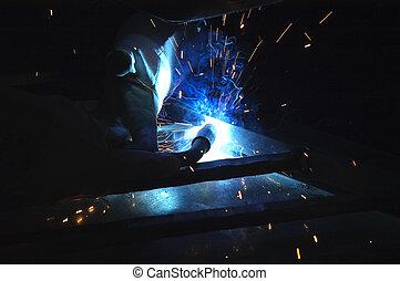 welder using torch