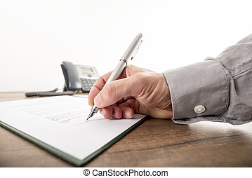 Closeup of businessman or lawyer signing an important...