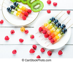 Mixed fruits and berries on skewers. studio shot