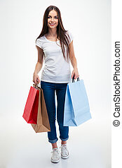 Woman holding shopping bags - Full length portrait of a...