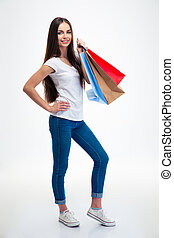 Attractive woman holding shopping bags - Full length...