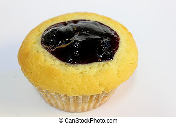 Blueberry muffin on white background filling ontop