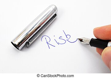 risk management concept with word on paper and pen