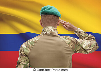 Dark-skinned soldier with flag on background - Colombia -...