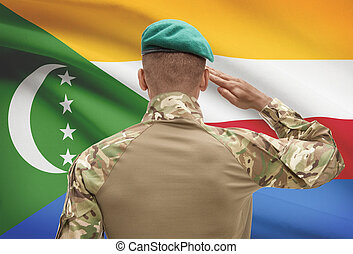 Dark-skinned soldier with flag on background - Comoros -...