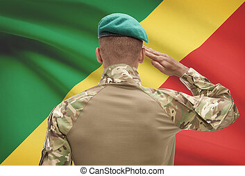 Dark-skinned soldier with flag on background -...
