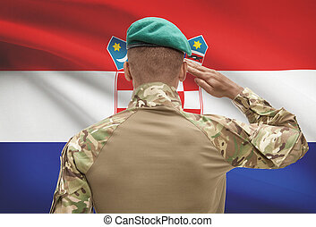 Dark-skinned soldier with flag on background - Croatia -...
