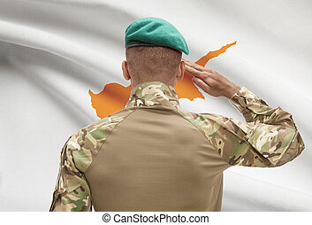 Dark-skinned soldier with flag on background - Cyprus -...
