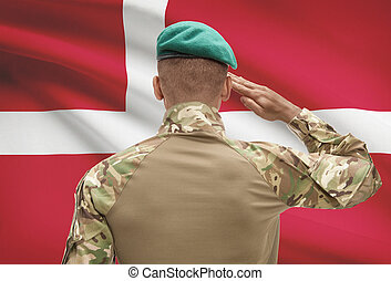 Dark-skinned soldier with flag on background - Denmark -...