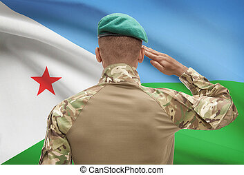Dark-skinned soldier with flag on background - Djibouti -...