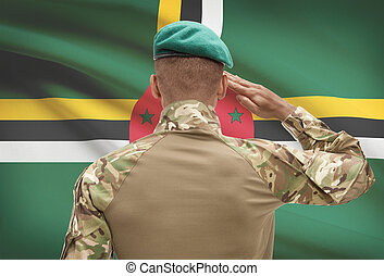 Dark-skinned soldier with flag on background - Dominica -...