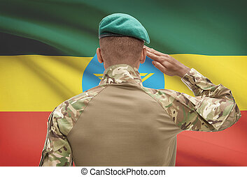 Dark-skinned soldier with flag on background - Ethiopia -...