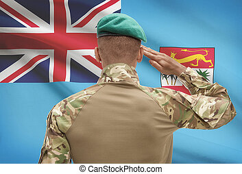 Dark-skinned soldier with flag on background - Fiji -...
