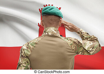 Dark-skinned soldier with flag on background - Gibraltar -...