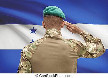 Dark-skinned soldier with flag on background - Honduras -...