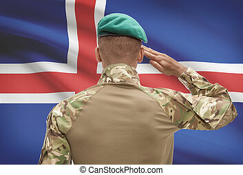 Dark-skinned soldier with flag on background - Iceland -...