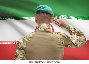 Dark-skinned soldier with flag on background - Iran -...