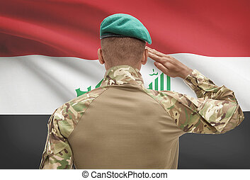 Dark-skinned soldier with flag on background - Iraq -...