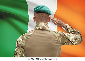 Dark-skinned soldier with flag on background - Ireland -...