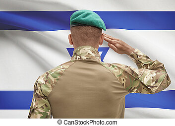 Dark-skinned soldier with flag on background - Israel -...