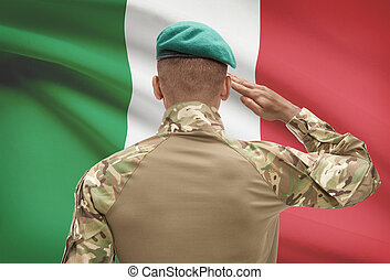 Dark-skinned soldier with flag on background - Italy -...